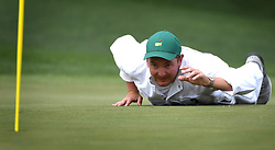 April 6, 2017 - Augusta, GA, USA - Matthew Fitzpatrick's caddie Jamie Lane lays on the 17th green lining up a putt during first round action of the 2017 Masters Tournament at Augusta National Golf Club on Thursday, April 6, 2017 in Augusta, Ga. Fitzpatrick finished the round at -1. (Credit Image: © Jeff Siner/TNS via ZUMA Wire)