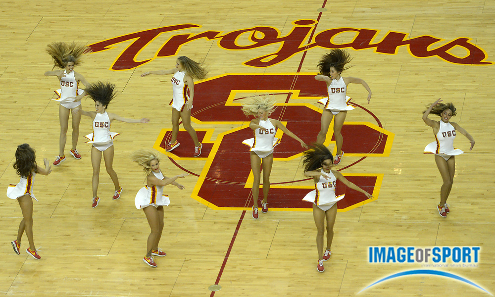 Nov 13, 2012; Los Angeles, CA, USA; Southern California Trojans song girls cheerleaders perform at midcourt on the USC logo during the basketball game against the Long Beach State 49ers at the Galen Center.