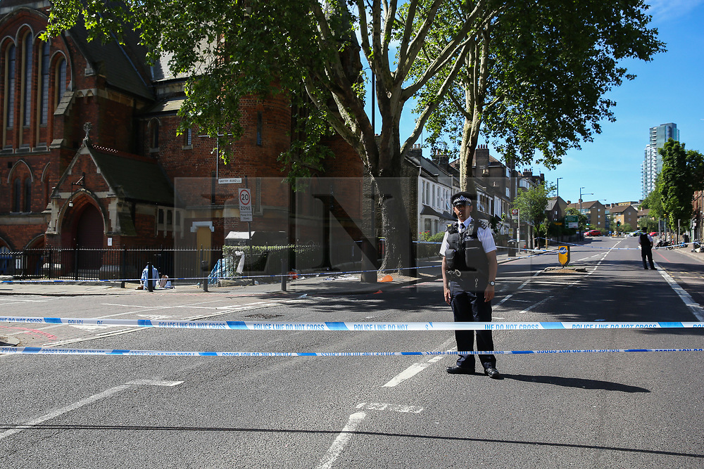 © Licensed to London News Pictures. 01/06/2019. London, UK. A police officer guards the crime scene on Seven Sisters Road, near the junction of Vartry Road in Haringey, north London, where a man in his 30s was found suffering from a stab wound to his leg. Police were called by London Ambulance Service just after 3am on Saturday, 1 June 2019. The victims condition in unknown.  Photo credit: Dinendra Haria/LNP