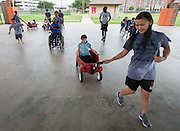 Home Run Hitters International staff, and volunteers work with students during Camp Mi Way at T.H. Rogers June 26, 2014.