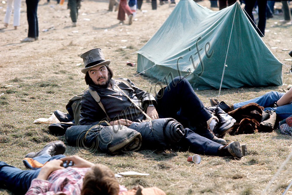 """""""Bob"""" the Hat.-.Laid back and obviously enjoying himself, the man in the hat was only one of estimated 600,000 festival goers that weekend.  .Charles Everest has the uncanny knack of capturing people at their most interesting. If you recognise """"Bob"""" the chap in his chapeau , we would love to hear from you."""