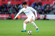 Swansea City's Ki Sung-Yueng in action. Premier league match, Swansea city v Watford at the Liberty Stadium in Swansea, South Wales on Saturday 22nd October 2016.<br /> pic by  Carl Robertson, Andrew Orchard sports photography.