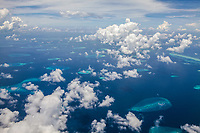 Aerial view above the clouds of the Arabian Sea, Maldives.