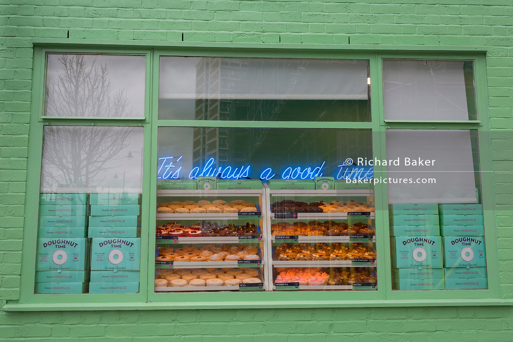 The enticing shop window of Doughnut Time on Old Street in Shoreditch and near Old Street roundabout, 7th March 2018, in London England. Doughnut Time is the creation of Austrlian entrepreneur Damian Griffiths, and has rapidly become an Australian success story with over 23 locations.