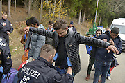 Nov. 11, 2015 - Wegscheid, Bavaria, Germany - GERMANY, Bavaria, Wegscheid; <br /> <br /> German police officials conduct their initial check of asylum seekers clothes and belongings before allowing them to board buses for onward transport to processing centres in Wegscheid and Passau, before further distribution across the country.<br /> ©Exclusivepix Media