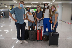 © Licensed to London News Pictures.  30/06/2021. Palma de Mallorca, Spain. Angus, Alicia, Maria, Tori and Karla from London arrive at Palma Airport in Mallorca as Balearic Islands are on the UK 'green list' from 4am, today. Photo credit: Marcin Nowak/LNP