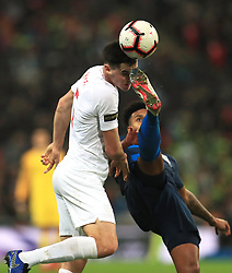 England's Michael Keane (left) in action during the International Friendly at Wembley Stadium, London. PRESS ASSOCIATION Photo. Picture date: Thursday November 15, 2018. See PA story SOCCER England. Photo credit should read: Mike Egerton/PA Wire. RESTRICTIONS: Use subject to FA restrictions. Editorial use only. Commercial use only with prior written consent of the FA. No editing except cropping.