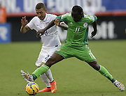 JACKSONVILLE, FL - JUNE 07:  Defender Fabian Johnson #23 of the United States battles for the ball with forward Victor Moses #11 of Nigeria during the international friendly match at EverBank Field on June 7, 2014 in Jacksonville, Florida.  (Photo by Mike Zarrilli/Getty Images)