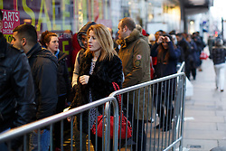 © licensed to London News Pictures. London, UK 26/12/2013. People queueing outside a Next branch on Oxford Street, London on Boxing Day. Photo credit: Tolga Akmen/LNP
