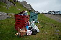 Overfilled trash bins at popular beach parking area, Uttakleiv, Lofoten Islands, Norway