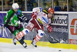 Harlan Pratt of Olimpija vs David Schuller of KAC at ice-hockey match in 33rd Round of EBEL league between HDD Tilia Olimpija Ljubljana and EC KAC, Klagenfurt, on December 18, 2009, in Arena Tivoli, Ljubljana, Slovenia. Olimpija defeated KAC 4:2. (Photo by Vid Ponikvar / Sportida)