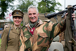 Reenactors portraying an Auxilary Territorial Service (ATS) woman and a Para from the 6th Airborne Division at Northallerton Wartime Weekend<br /> 18th and 19th June  2011<br /> Image © Paul David Drabble