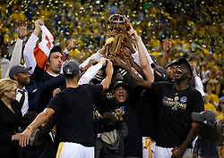 The Golden State Warriors, including owner Peter Guber, hold up the NBA Finals trophy after defeating the Cleveland Cavaliers, 129-120, in Game 5 of the NBA Finals at Oracle Arena in Oakland, Calif., on Monday, June 12, 2017. (Photo by Nhat V. Meyer/Bay Area News Group/TNS) *** Please Use Credit from Credit Field ***