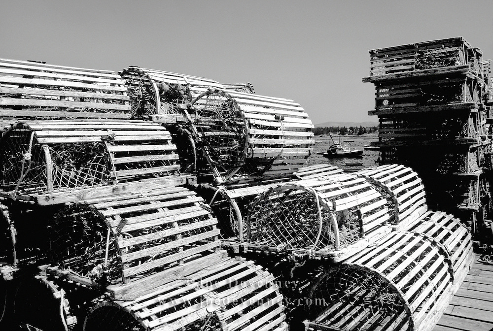 Old wooden lobster traps stacked on the dock at Bernard, Maine