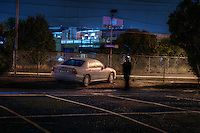 Railway Stations at night. West Footscray. About 7:30pm A man in the carpark finishes his cigarette while studying me from a distance, as I am in the shadow of a tree. Pic By Craig Sillitoe CSZ/The Sunday Age/The Age iPad App.15/6/2011 This photograph can be used for non commercial uses with attribution. Credit: Craig Sillitoe Photography / http://www.csillitoe.com<br /> <br /> It is protected under the Creative Commons Attribution-NonCommercial-ShareAlike 4.0 International License. To view a copy of this license, visit http://creativecommons.org/licenses/by-nc-sa/4.0/.