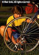 Bicycling, Pennsylvania, Outdoor recreation, Biking in PA, Female Rider Checks Tire Air Pressure