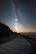The core of the Milky Way shines brilliantly over the Lake Michigan shore, as seen from Empire Bluff. <br /> Sleeping Bear Dunes National Lakeshore