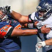 11/5/2016 - Orange Coast Pirate offensive lineman Marcus Horduno (77) defends an attack from Fullerton Hornet defensive lineman Domonic Sanchez (97) during the game at Orange Coast College - Costa Mesa, CA.<br /> <br /> ©2016 Jayme Spoolstra/Sports Shooter Academy