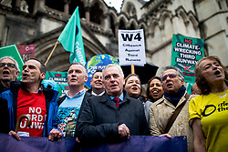 © Licensed to London News Pictures. 27/02/2020. London, UK. Shadow Chancellor John McDonnell (centre) joins protesters who oppose the expansion of Heathrow Airport outside the High Court. Judges will deliver their ruling on a number of appeals against the planned construction of a third runway at the London airport. Photo credit: Rob Pinney/LNP