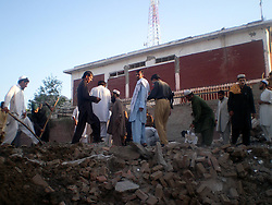 59614224  .Men work at the blast site in northwest Pakistan s Bannu, May 8, 2013. At least two were killed and 27 others injured when a suicide car bomb hit a police station in Pakistan s northwest Bannu district on Wednesday morning, reported local media, May 8, 2013. Photo by:  imago / i-Images.UK ONLY