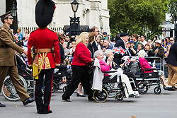 Whitehall, London, August 15th 2015. As Britain marks the 70th anniversary of victory against Japan in the Second World War, Hundreds of veterans from the campaign in South East Asia parade along Whitehall, past the Cenotaph.