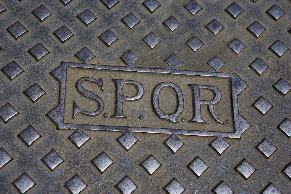 """SPQR on Roman Sewer Cover """"The Senate and People of Rome"""" Abbreviated phrase referring to the government of the ancient Roman Republic"""