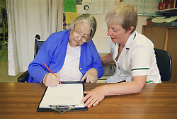 Occupational therapist with patient doing Rey figure copying test; which detects perceptual defects following stroke,