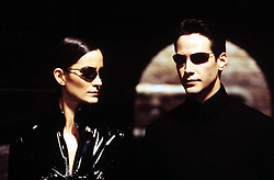 2003 - Carrie-Anne Moss and Keanu Reeves in a scene from Village Roadshow Pictures' provocative futuristic action thriller The Matrix Reloaded..A13022.MOVIE STILL (Credit Image: © Entertainment Pictures/ZUMApress.com)