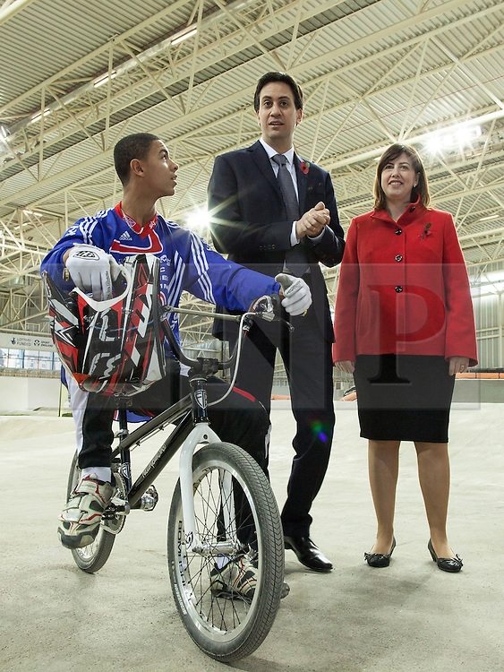 © Licensed to London News Pictures . 02/11/2012 . Manchester , UK . The leader of the Labour Party , Ed Miliband (centre) with Labour's candidate for Manchester Central , Lucy Powell (right) and 16 year old BMX World Champion Quillan Isidore (left) , at the BMX track at the National Cycling Centre in Manchester , today (Friday 2nd November 2012) . Mr Miliband joins Lucy Powell who is standing for the constituency of Manchester Central in the city's upcoming by-election . Photo credit : Joel Goodman/LNP