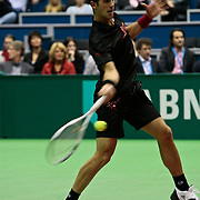 NLD/Rotterdam/20100209 - ABN - Amro Tennistoernooi 2010,  Novak Djokovic (black/red shirt) - Sergiy Stakhovsky (black/orange/white shirt)