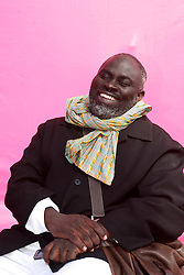 Dec 03 2007. New Orleans, Louisiana. Lower 9th Ward.<br /> Brad Pitt revisits the Lower 9th ward, devastated by Hurricane Katrina to present 'Make it Right' where architects' designs are unveiled to the public. One of the winning design Architects, Jo Addo of Constructs, Ghana with a pink background for the pink project.<br /> Photo credit; Charlie Varley.
