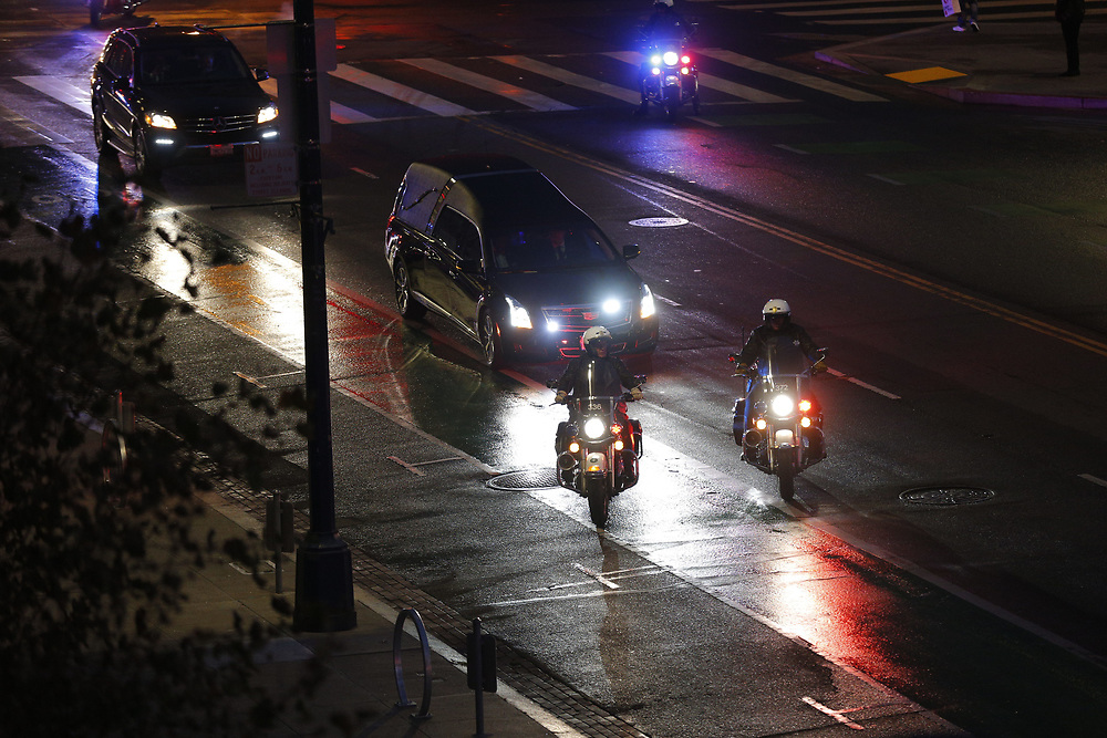 The casket of San Francisco Mayor Ed Lee is escorted to City Hall on Friday, Dec. 15, 2017, in San Francisco, Calif. Mayor Ed Lee was lain in state at the rotunda of City Hall. Lee died on Tuesday from a heart attack. He was 65 years old.