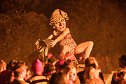 """Effigy of Theresa May bailing out a sinking ship<br /> <br /> Lewes Bonfire, describes a set of celebrations held in the town of Lewes, Sussex that constitute the United Kingdom's largest and most famous Bonfire Night festivities. Held on 5 November, the event not only marks Guy Fawkes Night - the date of the uncovering of the Gunpowder Plot in 1605 - but also commemorates the memory of the seventeen Protestant martyrs from the town burned at the stake for their faith during the Marian Persecutions. Lewes is home to the largest and most celebrated of the festivities in the Sussex bonfire tradition. There are seven societies putting on six separate parades and firework displays throughout Lewes on November the 5th. As well as this, 25-30 societies from all around Sussex come to Lewes on the fifth to march the streets. There is a history of religious antagonism and anti-popery around the bonfire celebrations in Lewes. A number of large effigies are drawn through the streets before being burned at the bonfires, these """"Enemies of Bonfire"""" range from nationally reviled figures to local officials."""