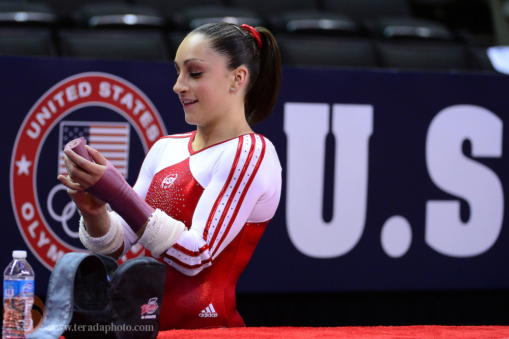 June 29, 2012; San Jose, CA, USA; Jordyn Wieber applies tape to her wrists during the 2012 USA Gymnastics Olympic Team Trials at HP Pavilion.