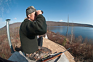 Glassing from whatever high vantage point one can find in this case a empty trappers cabin with a built in glassing area on the roof!