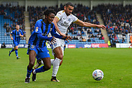 Gillingham FC midfielder Regan Charles-Cook (11) and Peterborough United defender Colin Daniel  (3) during the EFL Sky Bet League 1 match between Gillingham and Peterborough United at the MEMS Priestfield Stadium, Gillingham, England on 22 September 2018. Picture by Martin Cole