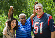 Houston ISD Board president Juliet Stipeche, left, and trustee Manuel Rodriguez, Jr, right, with Wretha Thomas, center, after taking the ALS Ice Bucket Challenge, August 21, 2014.