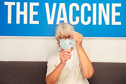 © Licensed to London News Pictures 18/07/2021. Greenwich, UK. A member of staff preparing a vaccination. Hundred of people turn up at a Pfizer covid vaccination event for over 18s in Greenwich Park, London today between noon and 7pm. Photo credit:Grant Falvey/LNP