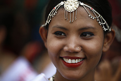 August 9, 2016 - Kathmandu, Nepal - A Nepalese woman smiles while taking part in a rally to mark International Day of the World's Indigenous Peoples in Kathmandu, Nepal on Tuesday, August 9, 2016. This day is celebrated worldwide to promote and protect the rights of the world's indigenous population. (Credit Image: © Skanda Gautam via ZUMA Wire)