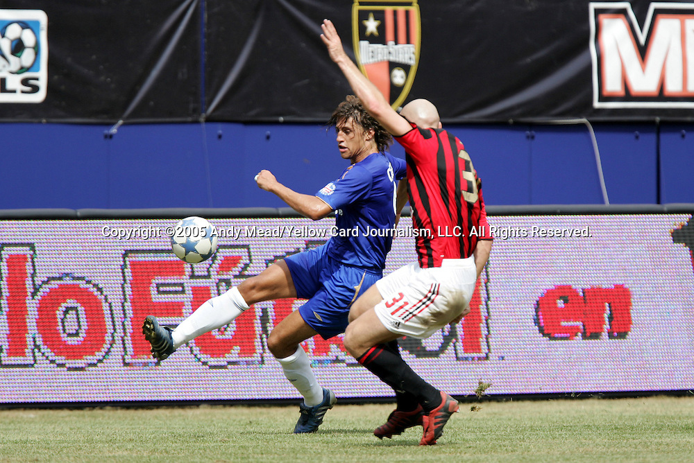 31 July 2005: Hernan Crespo (l) sends a cross past Jakob Stam (31). Chelsea FC of England and AC Milan of Spain tied 1-1 at Giants Stadium in East Rutherford, New Jersey in an international friendly soccer match as part of AEG's 2005 World Series of Football. .