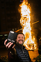 BONDENO, ITALY - 6 JANUARY 2020: Matteo Salvini, former Interior Minister of Italy and leader of the far-right League party,  takes a selfie with the burning Befana in Bondeno, Italy, on January 6th 2020.<br /> <br /> In Italian folklore, Befana is an old woman who delivers gifts to children throughout Italy on Epiphany Eve (the night of January 5) in a similar way to St Nicholas or Santa Claus.<br /> <br /> Matteo Salvini is campaigning in the region of Emilia Romagna to support the League candidate Lucia Borgonzoni running for governor.<br /> <br /> After being ousted from government in September 2019, Matteo Salvini has made it a priority to campaign in all the Italian regions undergoing regional elections to demonstrate that, in power or not, he still commands considerable support.<br /> <br /> The January 26th regional elections in Emilia Romagna, traditionally the home of the Italian left, has been targeted by Matteo Salvini as a catalyst for bringing down the government. A loss for the center-left Democratic Party (PD) against Mr Salvini's right would strip the centre-left party of control of its symbolic heartland, and probably trigger a crisis in its coalition with the Five Star Movement.
