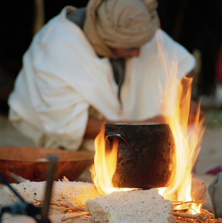 A camel tradel prepares food at camp in the Saharah desert in the south of Tunisia