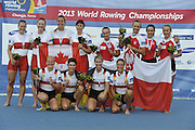 Chungju, South Korea.  Final Women's Quadruple Sculls Medel presentation, awards dock. 2013 FISA World Rowing Championships, Tangeum Lake International Regatta Course.16:48:13  Saturday  31/08/2013 [Mandatory Credit. Peter Spurrier/Intersport Images]<br /> <br /> 1GER W4X, Annekatrin THIELE (b) , Carina BAER (2) , Julia RICHTER (3) , Britta OPPELT (s)<br /> <br /> 2CAN W4X,Emily CAMERON (b) , Katharine GOODFELLOW (2) , Carling ZEEMAN (3) , Antje VON SEYDLITZ-KURZBACH (s)<br /> <br /> 3POLW4X Sylwia LEWANDOWSKA (b) , Joanna LESZCZYNSKA (2) , Magdalena FULARCZYK (3) , Natalia MADAJ