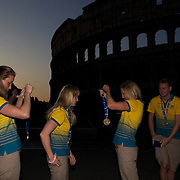 Australian Gold medal winners  prepare for a 6am photo shoot outside the  Coloseum. Pictured from left to right are Marieke Guehrer, Jessicah Schipper, Melissa Gorman and Brenton Rickard in Rome Italy on  Monday, August 03, 2009. Photo Tim Clayton.