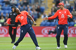 England's Jofra Archer (left) and Eoin Morgan during celebrates taking the wicket of Pakistan's Imam-ul-Haq duiring the Vitality IT20 match at Sophia Gardens, Cardiff.