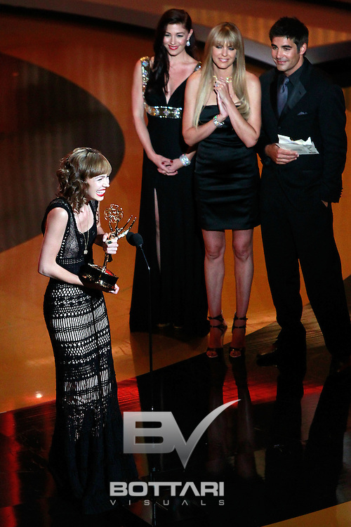 Actress Brittany Allen accepts the Outstanding Younger Actress award onstage while actors Galen Gering and Arianne Zucker look on during the Daytime Emmy Awards on Sunday June 19, 2011 in Las Vegas. (AP Photo/Jeff Bottari)