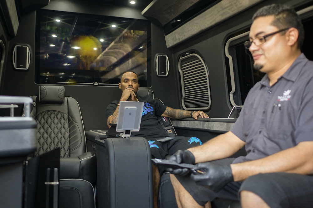 DORAL, FLORIDA, DECEMBER 11, 2015<br /> Jose Oyuela, right, of The Auto Firm, a South Florida car customizing and restoring shop which has a vast clientele of professional athletes and entertainers,  shows Atlanta rapper Peeto the Plug a customized Mercedes Benz limo van. The van sells for $175.000.<br /> (Photo by Angel Valentin/Freelance)