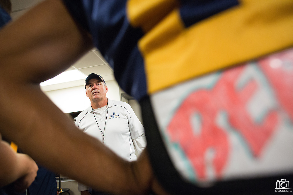 Coach Kelly King gives his team a pep-talk before Milpitas High School takes on Valley Christian High School during Friday Night Lights at Levi's Stadium in Santa Clara, California, on September 18, 2015. Milpitas went on to lose 22-21 against Valley Christian. (Stan Olszewski/SOSKIphoto)