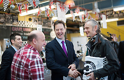 © London News Pictures. 30/01/2014. London, UK. Deputy Prime Minister NICK CLEGG (centre) talks to regulars at the Ace Cafe in North London where he announced a multi million pound funding allocation for more electric car charging points across the country. Photo credit: Ben Cawthra/LNP