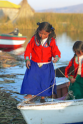 Young Uros Girls On Boat